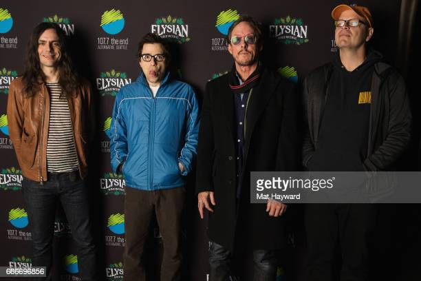 Brian Bell Rivers Cuomo Scott Shriner and Patrick Wilson of Weezer pose for a photo before performing at The Showbox on April 9 2017 in Seattle...