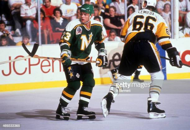 Brian Bellows of the Minnesota North Stars defends against Mario Lemieux of the Pittsburgh Penguins during the 1991 Stanley Cup Finals on May 1991 at...