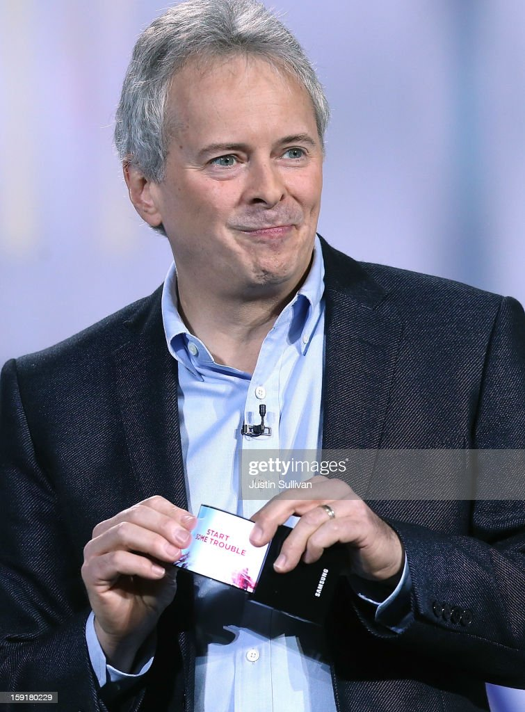 Brian Berkeley Samsung Electronics senior vice president of Samsung's display lab shows a prototype of the YOUM Flexible display during a keynote...