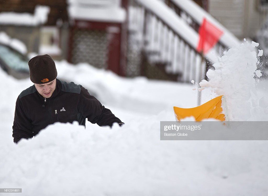 Brian Bernard digs out the snow in front of his home on Saturday, Feb. 9, 2013.