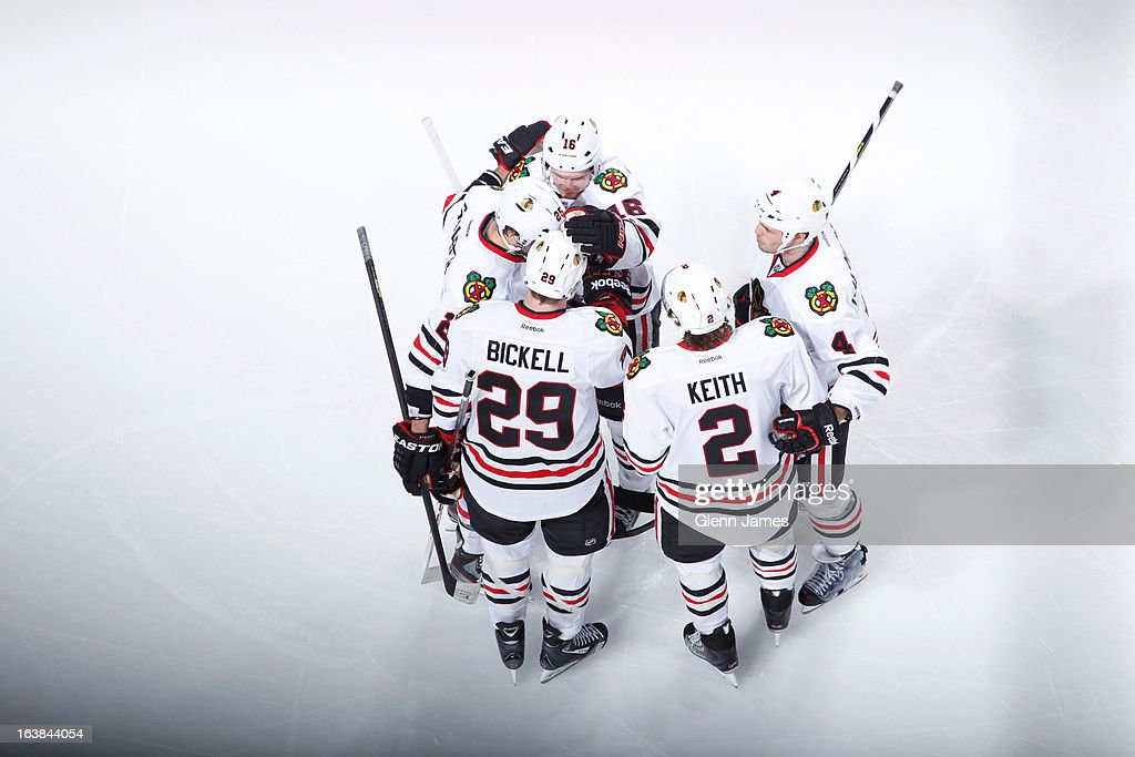 Brian Bickell #29, <a gi-track='captionPersonalityLinkClicked' href=/galleries/search?phrase=Duncan+Keith&family=editorial&specificpeople=4194433 ng-click='$event.stopPropagation()'>Duncan Keith</a> #2 and the Chicago Blackhawks celebrate a goal against the Dallas Stars at the American Airlines Center on March 16, 2013 in Dallas, Texas.
