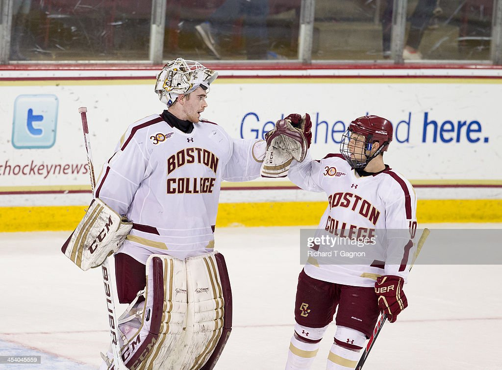 Brian Billett #1 of the Boston College Eagles celebrates a win with Danny Linell #10 against the New Hampshire Wildcats during NCAA hockey action at Kelley Rink on December 6, 2013 in Chestnut Hill, Massachusetts.