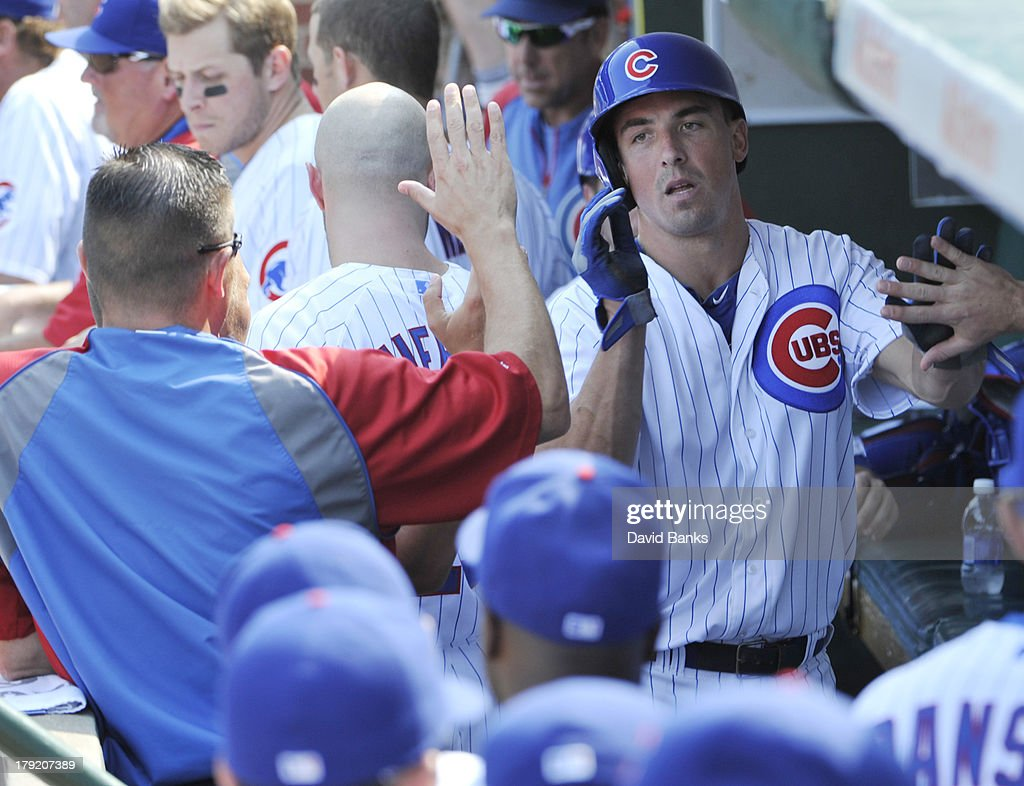 Brian Bogusevic #47 of the Chicago Cubs is greeted by teammates after scoring against the Philadelphia Phillies during the fourth inning on September 1, 2013 at Wrigley Field in Chicago, Illinois.