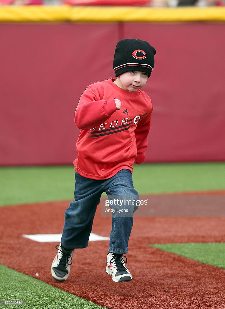 Brian Bosse runs the bases on a baseball diamond for children before the start of the Los Angeles Angels of Anaheim game against the Cincinnati Reds at Great American Ball Park on April 1, 2013 in Cincinnati, Ohio.