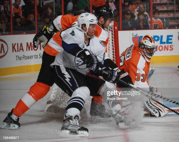 Brian Boucher and Chris Pronger of the Philadelphia Flyers defend against Ryan Malone of the Tampa Bay Lightning at the Wells Fargo Center on October...