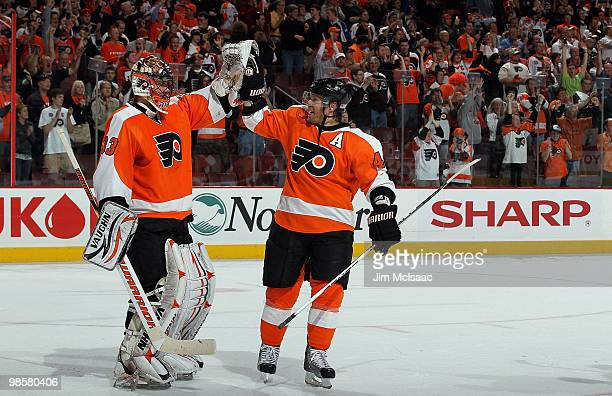 Brian Boucher and Kimmo Timonen of the Philadelphia Flyers celebrate after defeating the New Jersey Devils in Game Four of the Eastern Conference...