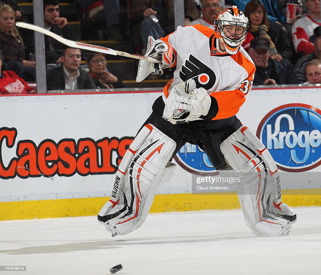 <a gi-track='captionPersonalityLinkClicked' href=/galleries/search?phrase=Brian+Boucher&family=editorial&specificpeople=179370 ng-click='$event.stopPropagation()'>Brian Boucher</a> #33 of the Philadelphia Flyers clears the puck out of harms way in a game against the Detroit Red Wings on January 2, 2011 at the Joe Louis Arena in Detroit, Michigan. The Flyers defeated the Wings 3-2.