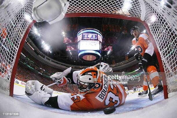 Brian Boucher of the Philadelphia Flyers fails to block a third period goal by Tyler Myers of the Buffalo Sabres in Game Seven of the Eastern...