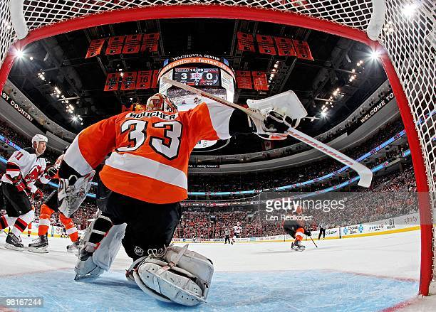 Brian Boucher of the Philadelphia Flyers stops a shot on goal by Dean McAmmond of the New Jersey Devils on March 28 2010 at the Wachovia Center in...