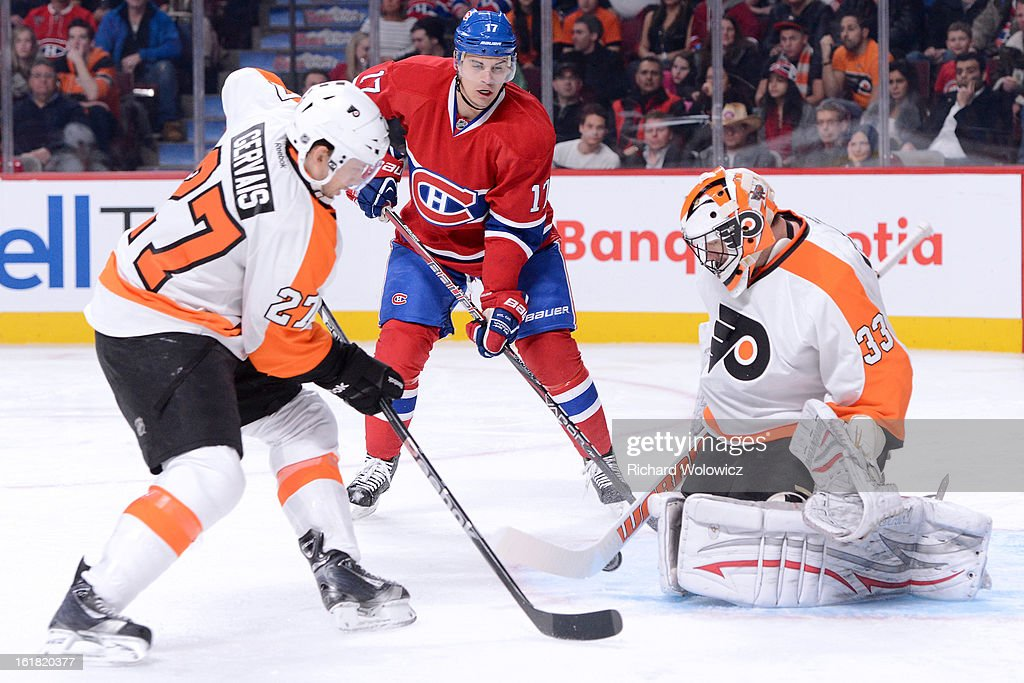 <a gi-track='captionPersonalityLinkClicked' href=/galleries/search?phrase=Brian+Boucher&family=editorial&specificpeople=179370 ng-click='$event.stopPropagation()'>Brian Boucher</a> #33 of the Philadelphia Flyers stops the puck in front of <a gi-track='captionPersonalityLinkClicked' href=/galleries/search?phrase=Rene+Bourque&family=editorial&specificpeople=685715 ng-click='$event.stopPropagation()'>Rene Bourque</a> #17 of the Montreal Canadiens during the NHL game at the Bell Centre on February 16, 2013 in Montreal, Quebec, Canada. The Canadiens defeated the Flyers 4-1.
