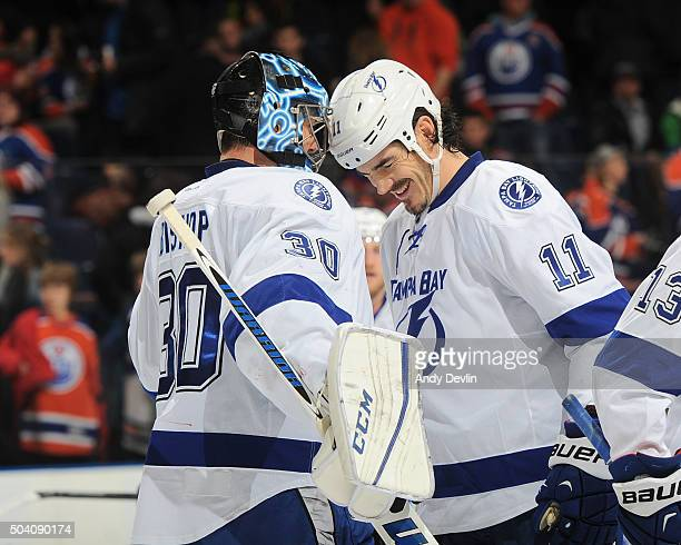 Brian Boyle and Ben Bishop of the Tampa Bay Lightning celebrate after winning the game against the Edmonton Oilers on January 8 2016 at Rexall Place...