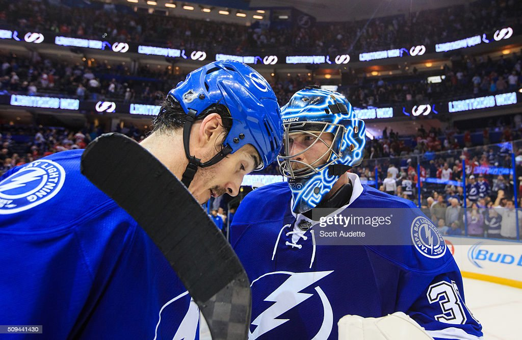 <a gi-track='captionPersonalityLinkClicked' href=/galleries/search?phrase=Brian+Boyle+-+Hockey+sur+glace&family=editorial&specificpeople=8986264 ng-click='$event.stopPropagation()'>Brian Boyle</a> #11 and goalie <a gi-track='captionPersonalityLinkClicked' href=/galleries/search?phrase=Ben+Bishop&family=editorial&specificpeople=700137 ng-click='$event.stopPropagation()'>Ben Bishop</a> #30 of the Tampa Bay Lightning celebrate the win against the Detroit Red Wings at the Amalie Arena on February 3, 2016 in Tampa, Florida.