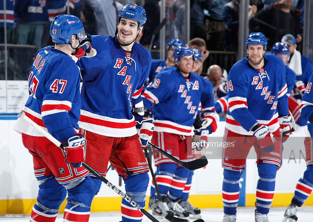 Brian Boyle #22 and J.T. Miller #47 of the New York Rangers celebrate a shootout victory against the Carolina Hurricanes at Madison Square Garden on March 18, 2013 in New York City.