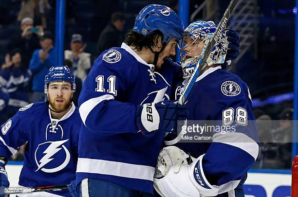 Brian Boyle celebrates a win with goalie Andrei Vasilevskiy of the Tampa Bay Lightning against the Edmonton Oilers at the end of the third period at...