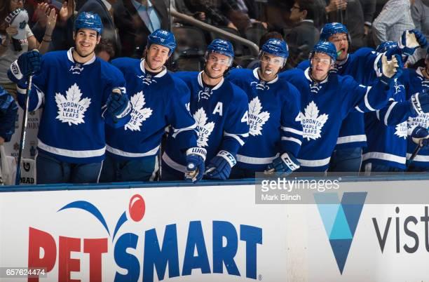 Brian Boyle Matt Martin Tyler Bozak Nazem Kadri Connor Brown and James van Riemsdyk of the Toronto Maple Leafs celebrate a goal by their teammate...