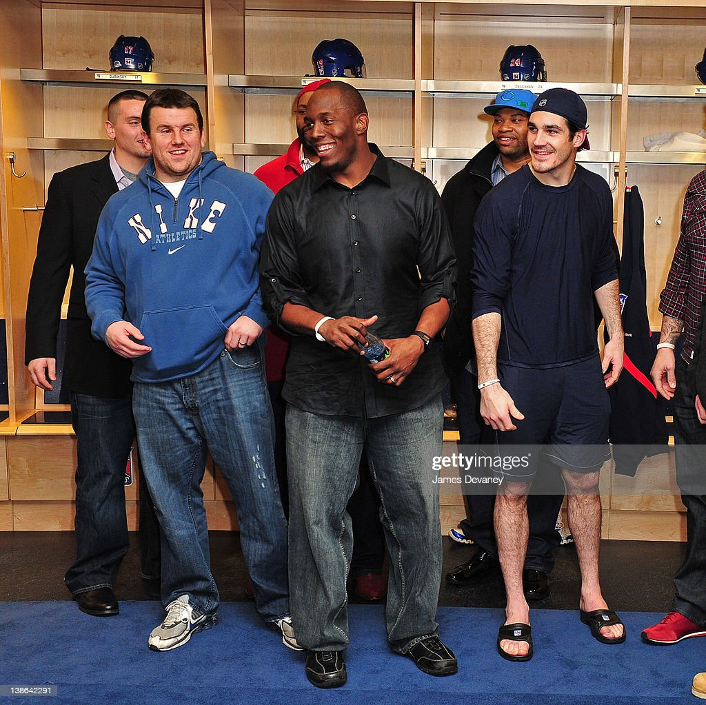 Brian Boyle meets New York Giants players in the Rangers locker room after the Tampa Bay Lightning vs the New York Rangers game at Madison Square Garden on February 9, 2012 in New York City.