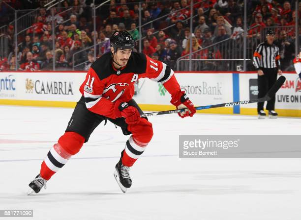 Brian Boyle of the New Jersey Devils skates against the Florida Panthers at the Prudential Center on November 27 2017 in Newark New Jersey The...