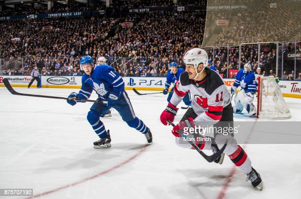 Brian Boyle of the New Jersey Devils skates against Zach Hyman of the Toronto Maple Leafs during the second period at the Air Canada Centre on...