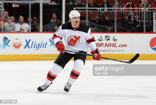 Brian Boyle of the New Jersey Devils skates up ice against the Arizona Coyotes at Gila River Arena on December 2 2017 in Glendale Arizona