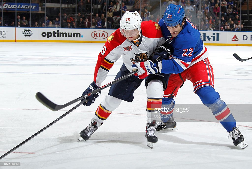 Brian Boyle #22 of the New York Rangers and <a gi-track='captionPersonalityLinkClicked' href=/galleries/search?phrase=Aleksander+Barkov&family=editorial&specificpeople=8760147 ng-click='$event.stopPropagation()'>Aleksander Barkov</a> #16 of the Florida Panthers battle for the puck at Madison Square Garden on November 10, 2013 in New York City.