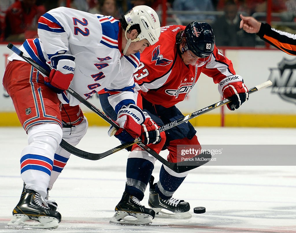Brian Boyle #22 of the New York Rangers and <a gi-track='captionPersonalityLinkClicked' href=/galleries/search?phrase=Jay+Beagle&family=editorial&specificpeople=4671535 ng-click='$event.stopPropagation()'>Jay Beagle</a> #83 of the Washington Capitals take a face-off during an NHL game at Verizon Center on October 16, 2013 in Washington, DC.