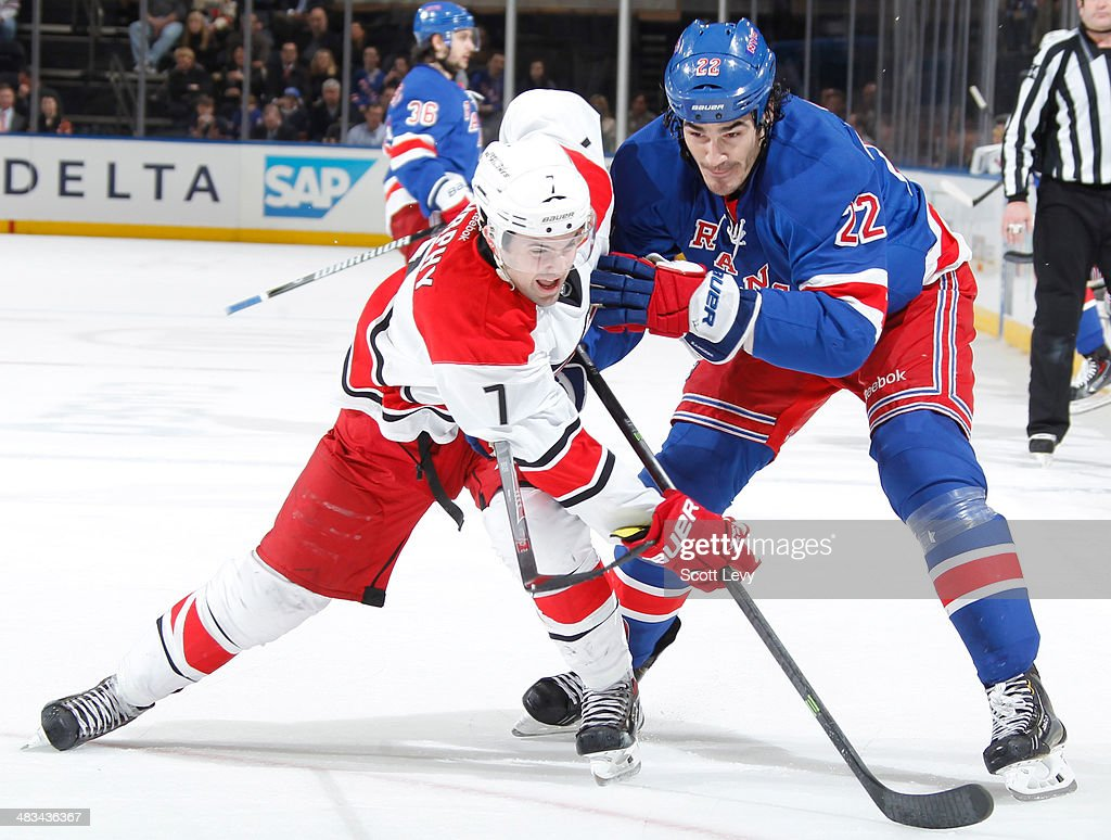 Brian Boyle #22 of the New York Rangers and Ryan Murphy #7 of the Carolina Hurricanes battle for the puck at Madison Square Garden on April 08, 2014 in New York City.