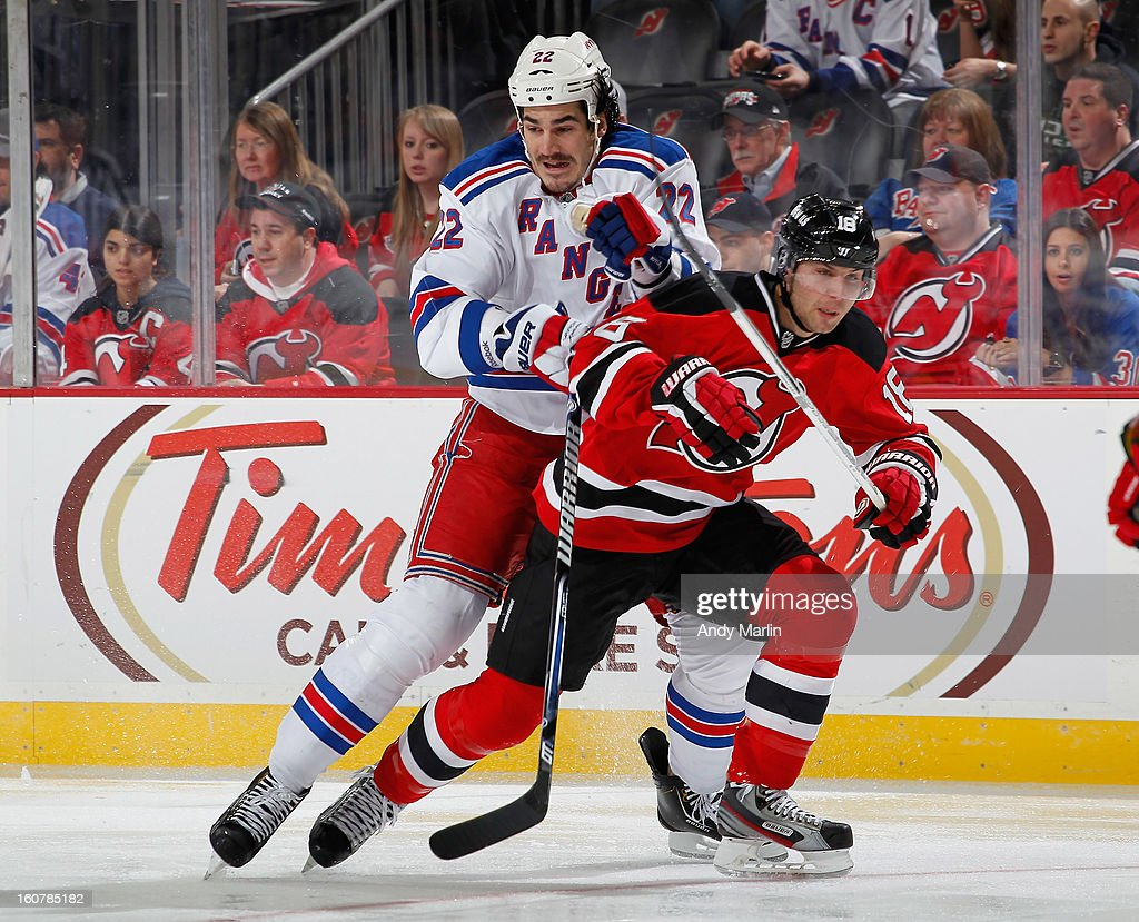 Brian Boyle #22 of the New York Rangers and <a gi-track='captionPersonalityLinkClicked' href=/galleries/search?phrase=Steve+Bernier&family=editorial&specificpeople=557040 ng-click='$event.stopPropagation()'>Steve Bernier</a> #18 of the New Jersey Devils battle for position during the game at the Prudential Center on February 5, 2013 in Newark, New Jersey.