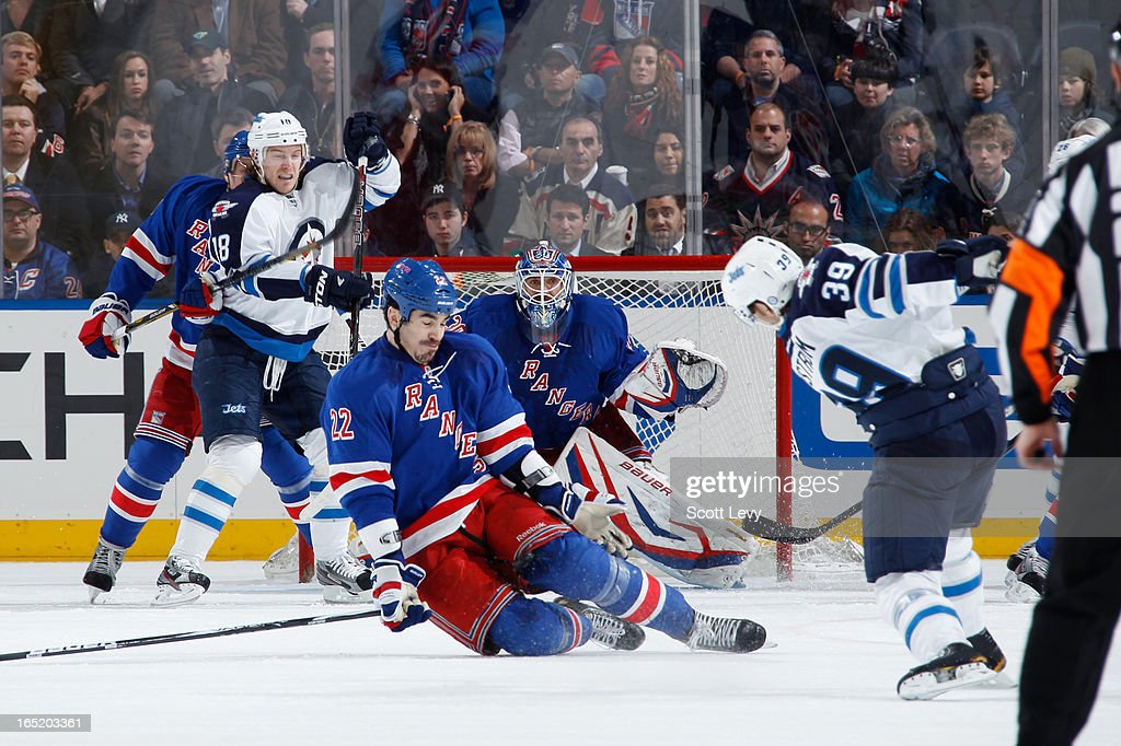 Brian Boyle #22 of the New York Rangers blocks a shot by <a gi-track='captionPersonalityLinkClicked' href=/galleries/search?phrase=Tobias+Enstrom&family=editorial&specificpeople=2538468 ng-click='$event.stopPropagation()'>Tobias Enstrom</a> #39 of the Winnipeg Jets at Madison Square Garden on April 1, 2013 in New York City.