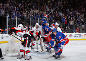 Brian Boyle of the New York Rangers celebrates his third period goal against Craig Anderson of the Ottawa Senators in Game Two of the Eastern...