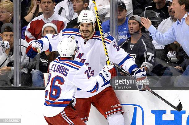 Brian Boyle of the New York Rangers celebrates with teammate Martin St Louis after Boyle scores a second period goal past goaltender Jonathan Quick...