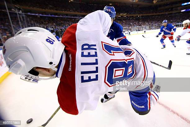 Brian Boyle of the New York Rangers checks Brendan Gallagher of the Montreal Canadiens into the boards in Game Three of the Eastern Conference Final...