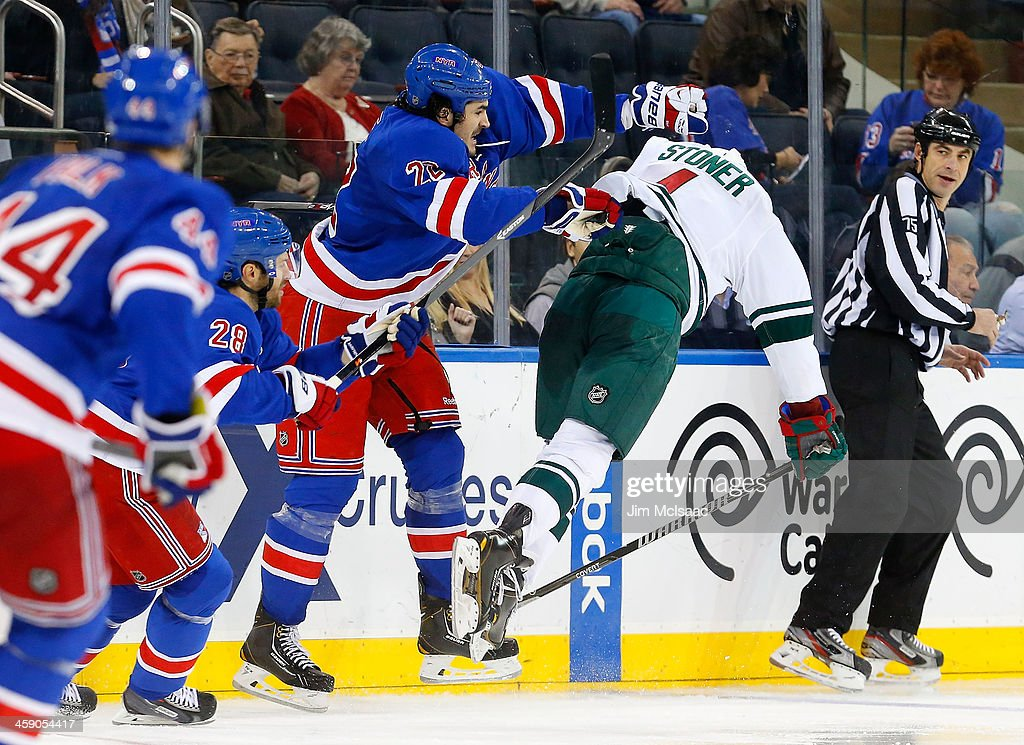 Brian Boyle #22 of the New York Rangers checks <a gi-track='captionPersonalityLinkClicked' href=/galleries/search?phrase=Clayton+Stoner&family=editorial&specificpeople=2222214 ng-click='$event.stopPropagation()'>Clayton Stoner</a> #4 of the Minnesota Wild during the third period at Madison Square Garden on December 22, 2013 in New York City.