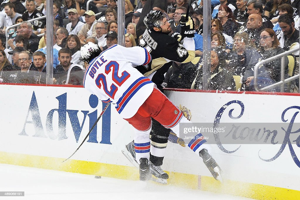 Brian Boyle #22 of the New York Rangers checks Robert Bortuzzo #41 of the Pittsburgh Penguins off the puck in the first period in Game Five of the Second Round of the 2014 NHL Stanley Cup Playoffs on May 9, 2014 at CONSOL Energy Center in Pittsburgh, Pennsylvania. New York defeated Pittsburgh 5-1.
