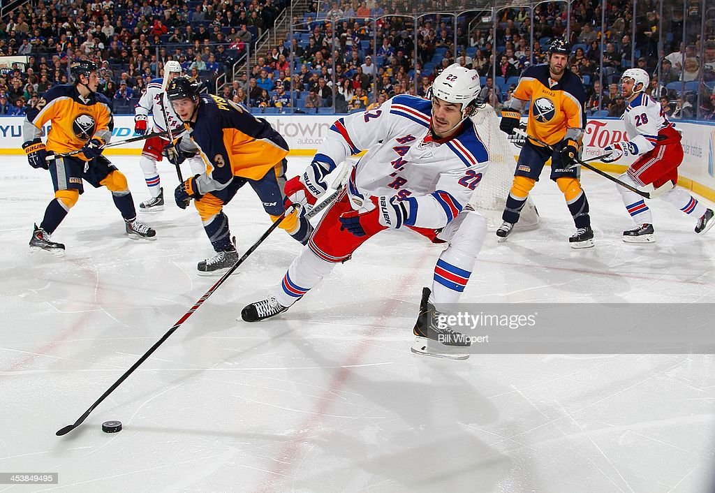 Brian Boyle #22 of the New York Rangers controls the puck against <a gi-track='captionPersonalityLinkClicked' href=/galleries/search?phrase=Mark+Pysyk&family=editorial&specificpeople=6571526 ng-click='$event.stopPropagation()'>Mark Pysyk</a> #3 of the Buffalo Sabres on December 5, 2013 at the First Niagara Center in Buffalo, New York.