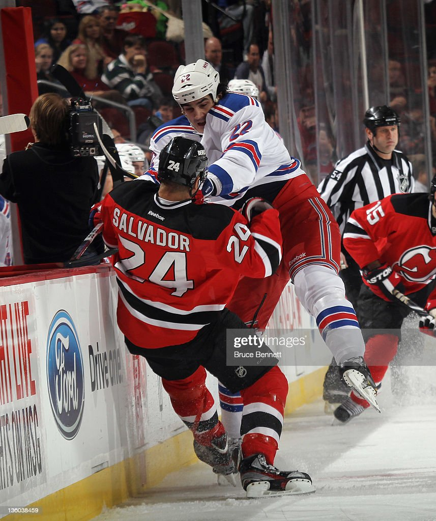 Brian Boyle #22 of the New York Rangers hits <a gi-track='captionPersonalityLinkClicked' href=/galleries/search?phrase=Bryce+Salvador&family=editorial&specificpeople=208746 ng-click='$event.stopPropagation()'>Bryce Salvador</a> #24 of the New Jersey Devils during first period action at the Prudential Center on December 20, 2011 in Newark, New Jersey.