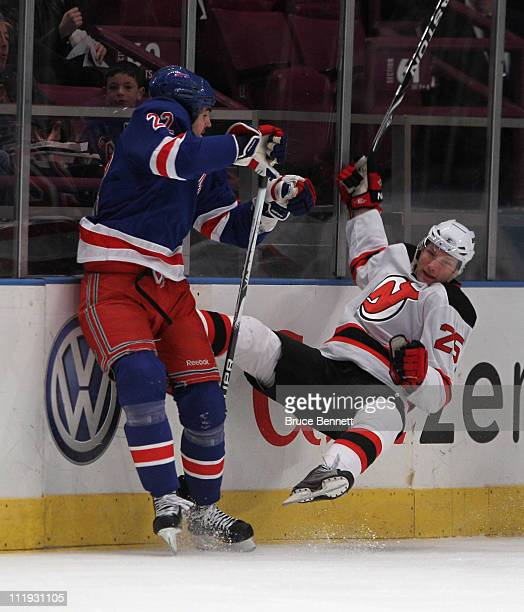 Brian Boyle of the New York Rangers hits David Steckel of the New Jersey Devils at Madison Square Garden on April 9 2011 in New York City