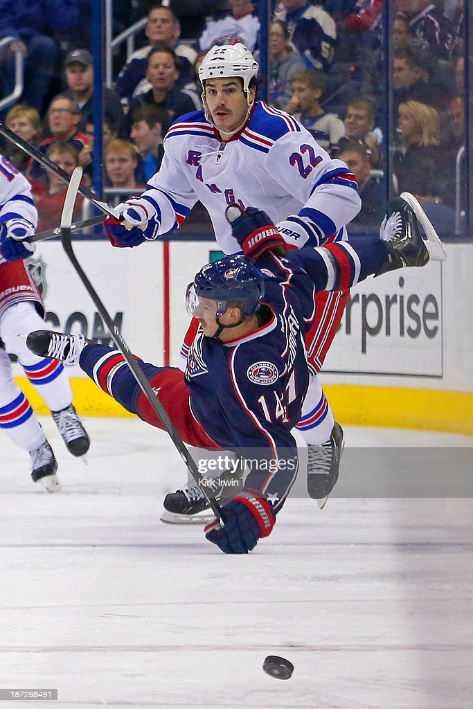 Brian Boyle #22 of the New York Rangers knocks down <a gi-track='captionPersonalityLinkClicked' href=/galleries/search?phrase=Blake+Comeau&family=editorial&specificpeople=879782 ng-click='$event.stopPropagation()'>Blake Comeau</a> #14 of the Columbus Blue Jackets during the third period on November 7, 2013 at Nationwide Arena in Columbus, Ohio. New York defeated Columbus 4-2.
