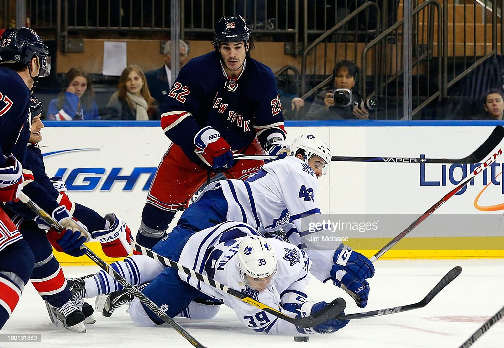 Brian Boyle #22 of the New York Rangers looks on as <a gi-track='captionPersonalityLinkClicked' href=/galleries/search?phrase=Nazem+Kadri&family=editorial&specificpeople=4043234 ng-click='$event.stopPropagation()'>Nazem Kadri</a> #43 of the Toronto Maple Leafs falls over teammate Matt Frattin #39 in the third period at Madison Square Garden on January 26, 2013 in New York City.
