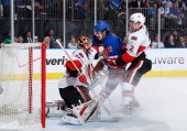 Brian Boyle of the New York Rangers positions himself in front of the net against Craig Anderson of the Ottawa Senators in Game One of the Eastern...