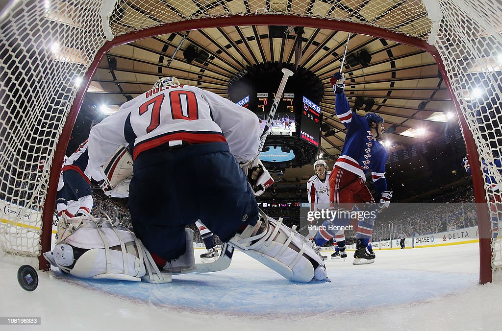 Brian Boyle #22 of the New York Rangers scores at 12:50 of the first period against <a gi-track='captionPersonalityLinkClicked' href=/galleries/search?phrase=Braden+Holtby&family=editorial&specificpeople=5370964 ng-click='$event.stopPropagation()'>Braden Holtby</a> #70 of the Washington Capitals in Game Three of the Eastern Conference Quarterfinals during the 2013 NHL Stanley Cup Playoffs at Madison Square Garden on May 6, 2013 in New York City. The Rangers defeated the Capitals 4-3.