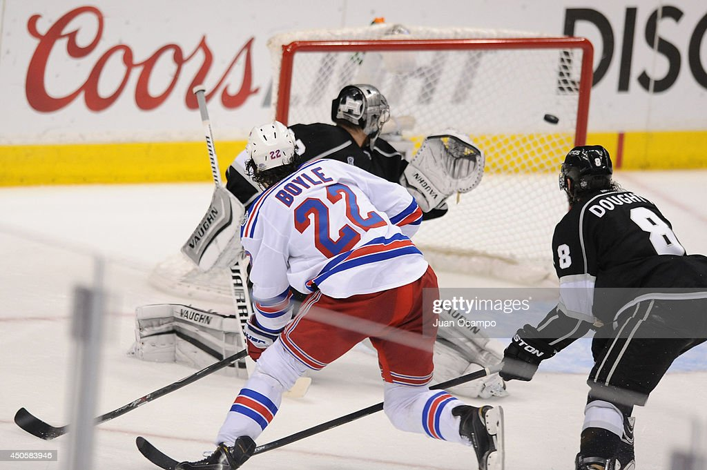 Brian Boyle #22 of the New York Rangers sends the puck through the net against Jonathan Quick #32 of the Los Angeles Kings in the second period of Game Five of the 2014 NHL Stanley Cup Final at Staples Center on June 13, 2014 in Los Angeles, California.