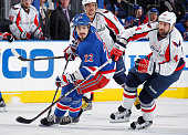 Brian Boyle of the New York Rangers skates against John Erskine of the Washington Capitals in Game Five of the Eastern Conference Semifinals during...