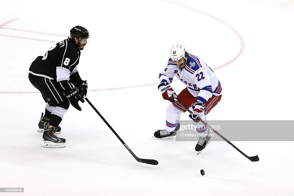 Brian Boyle #22 of the New York Rangers skates past Drew Doughty #8 before he scores a second period goal past goaltender Jonathan Quick #32 of the Los Angeles Kings during Game Five of the 2014 Stanley Cup Final at Staples Center on June 13, 2014 in Los Angeles, California.