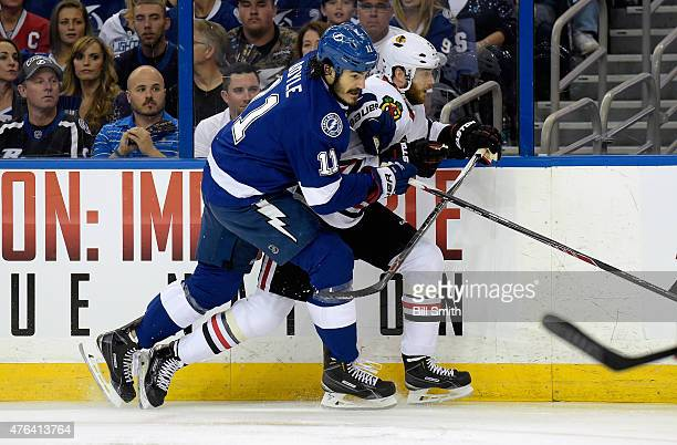 Brian Boyle of the Tampa Bay Lightning and David Rundblad of the Chicago Blackhawks battle at the boards during the first period of Game One of the...