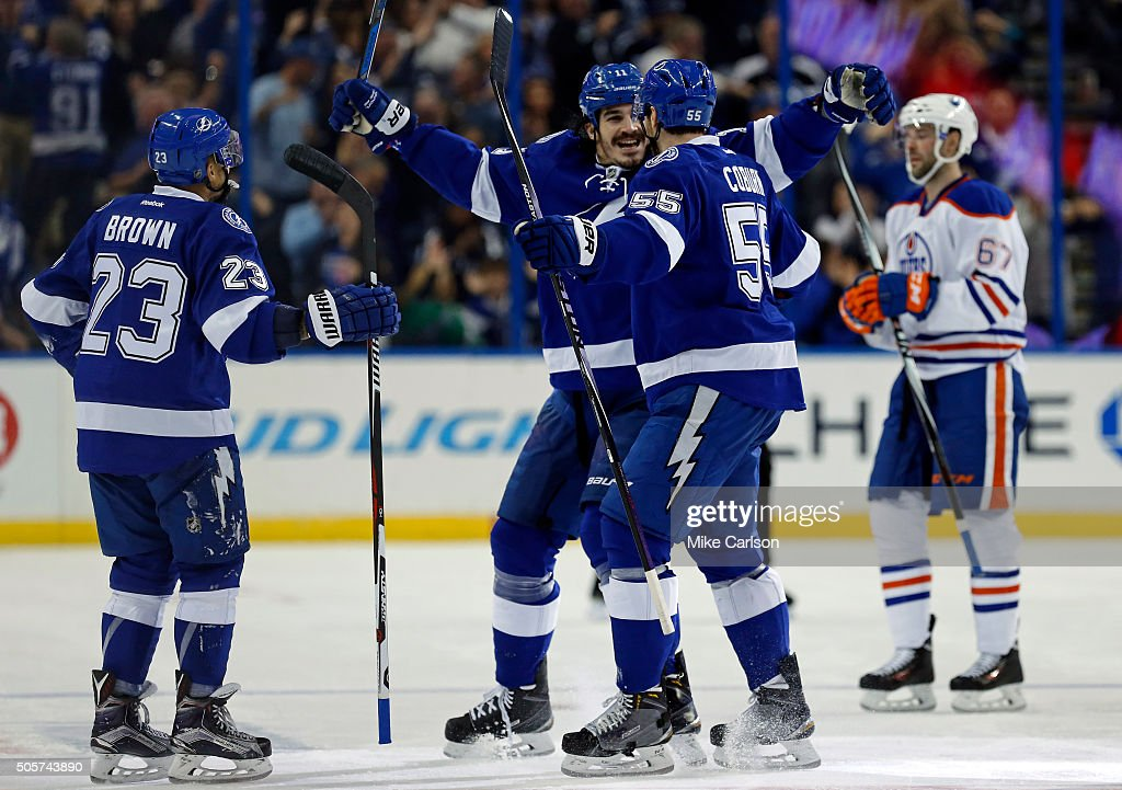 <a gi-track='captionPersonalityLinkClicked' href=/galleries/search?phrase=Brian+Boyle+-+IJshockeyer&family=editorial&specificpeople=8986264 ng-click='$event.stopPropagation()'>Brian Boyle</a> #11 of the Tampa Bay Lightning celebrates his goal with <a gi-track='captionPersonalityLinkClicked' href=/galleries/search?phrase=J.T.+Brown+-+IJshockeyer&family=editorial&specificpeople=10853804 ng-click='$event.stopPropagation()'>J.T. Brown</a> #23 and <a gi-track='captionPersonalityLinkClicked' href=/galleries/search?phrase=Braydon+Coburn&family=editorial&specificpeople=2077063 ng-click='$event.stopPropagation()'>Braydon Coburn</a> #55 as <a gi-track='captionPersonalityLinkClicked' href=/galleries/search?phrase=Benoit+Pouliot&family=editorial&specificpeople=879830 ng-click='$event.stopPropagation()'>Benoit Pouliot</a> #67 of the Edmonton Oilers reacts during the third period at the Amalie Arena on January 19, 2016 in Tampa, Florida.