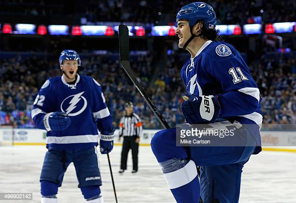 Brian Boyle of the Tampa Bay Lightning celebrates his goal with teammate Andrej Sustr against the Calgary Flames at the Amalie Arena on November 12...
