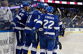 Brian Boyle of the Tampa Bay Lightning celebrates his goal with teammates including Andrej Sustr and Erik Condra against the Calgary Flames at the...