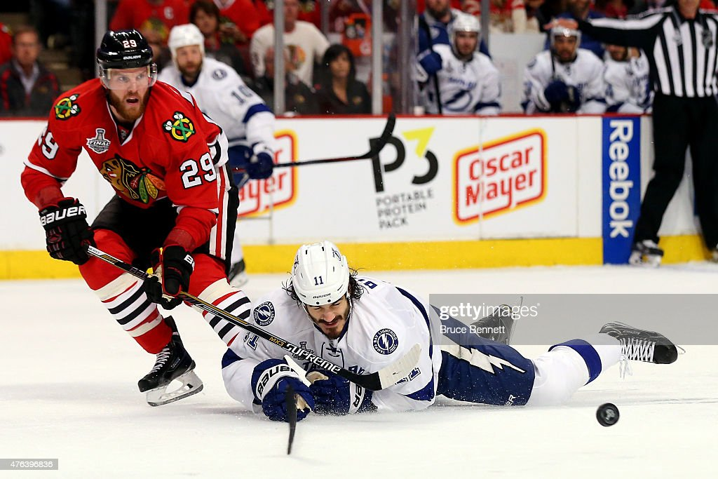 Brian Boyle #11 of the Tampa Bay Lightning dives for a puck in the second period against Bryan Bickell #29 of the Chicago Blackhawks during Game Three of the 2015 NHL Stanley Cup Final at the United Center on June 8, 2015 in Chicago, Illinois.