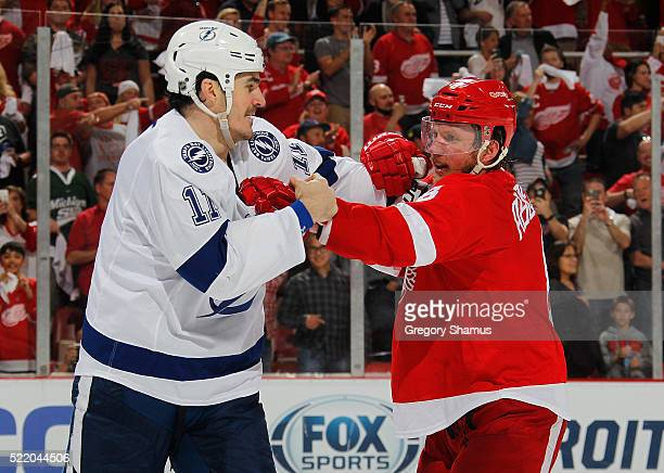 Brian Boyle of the Tampa Bay Lightning looks for a fight with Justin Abdelkader of the Detroit Red Wings after the conclusion of Game Three of the...