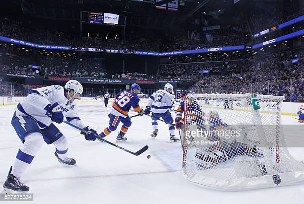 Brian Boyle of the Tampa Bay Lightning scores the game winning goal at 248 of the first overtime against Thomas Greiss of the New York Islanders in...